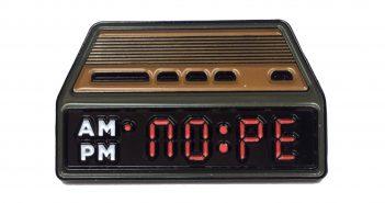 nope alarm clock hitting snooze button