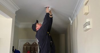 firefighter changing smoke detector