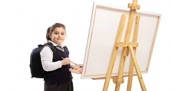 child at an easel, art